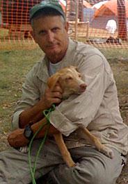 Humane Society International responder Lloyd Brown holds a dog in Haiti