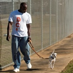 An inmate and a dog walking at the Dixon shelter in Louisiana