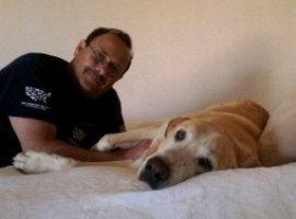 HSUS driver Perry Stone with his dog Duke, rescued from an Arizona hoarding case