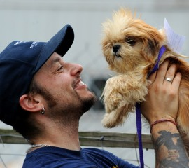 Adam Parascandola of The HSUS holds one of the rescued dogs