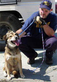 HSUS staff person with dog rescued after Hurricane Katrina