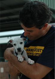 Wayne Pacelle with puppy after Hurricane Katrina