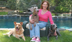 Author and radio host Tracie Hotchner with her three dogs