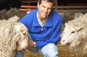 Farm Sanctuary President and Co-Founder Gene Baur with two sheep